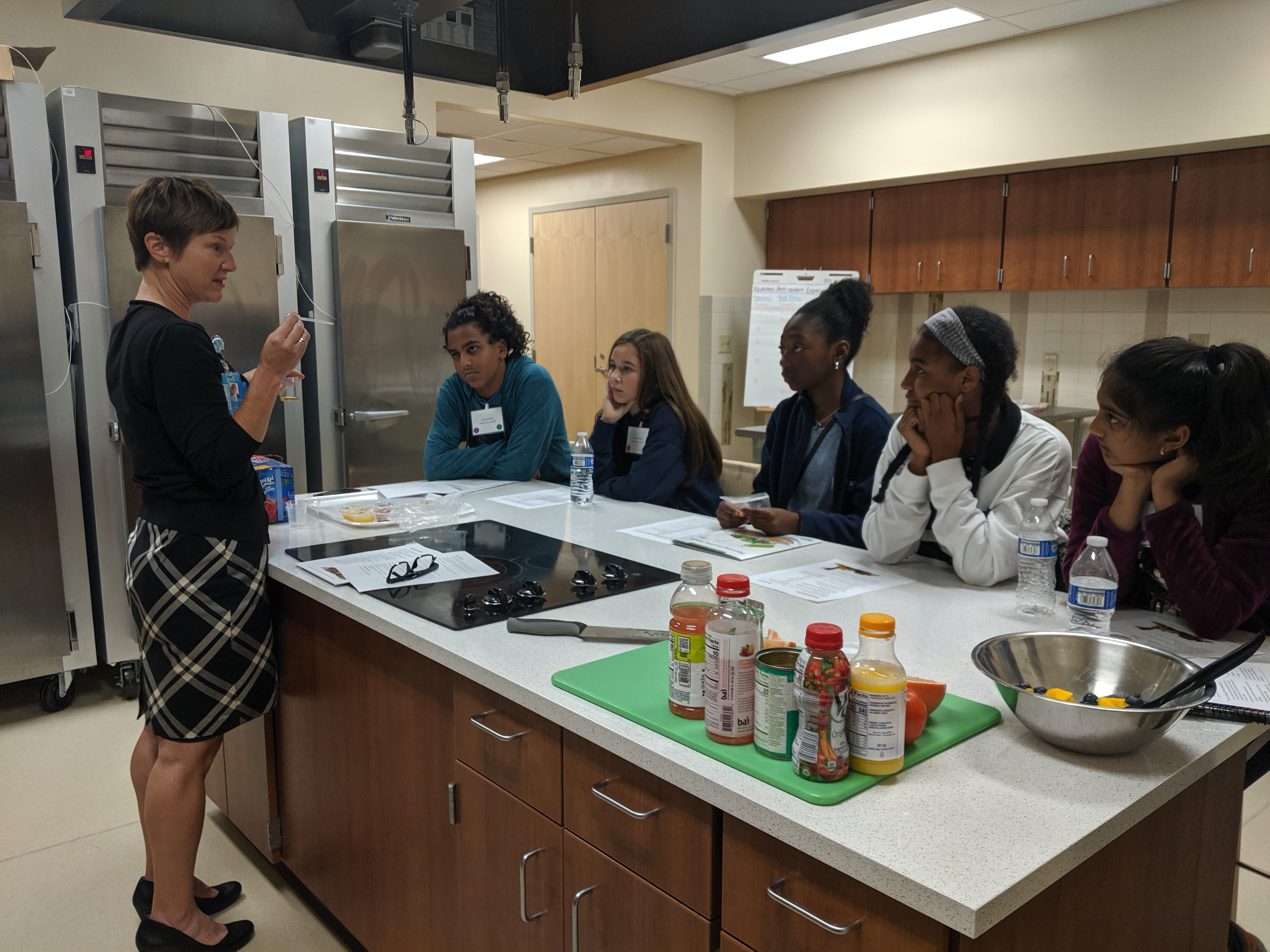 Students from the MSSS prepare for a nutrition experiment in the SRC metabolic kitchen led by Suzanne Summer.